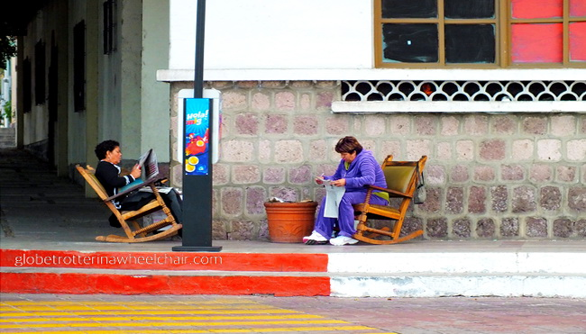 Two ladies reading the newspaper in La Paz, Mexico