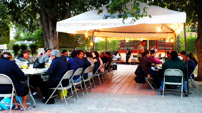 A lot of people playing bingo at the city square. in La Paz, Mexico