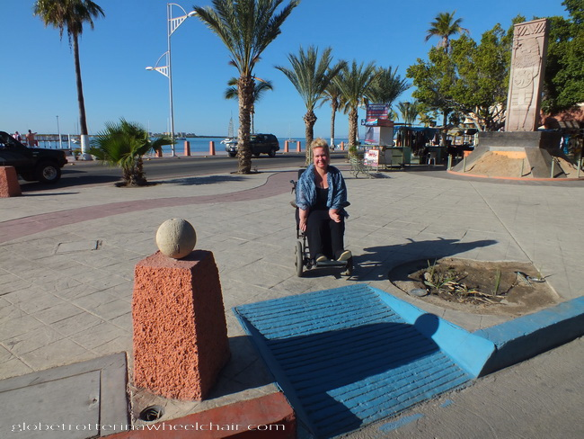 A woman in a wheelchair sitting in front of a ramp a ramp in La Paz, Mexico