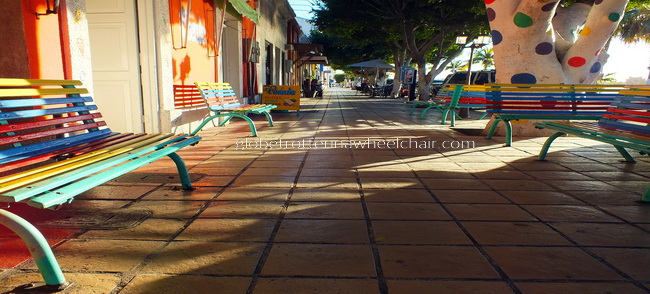 sidewalk with colored benches and painted trees in La Paz, Mexico