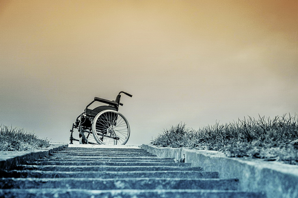 Curious and traveling in a Wheelchair - wheelchair at the end of a staircase. it's about accessibility and traveling in a wheelchair