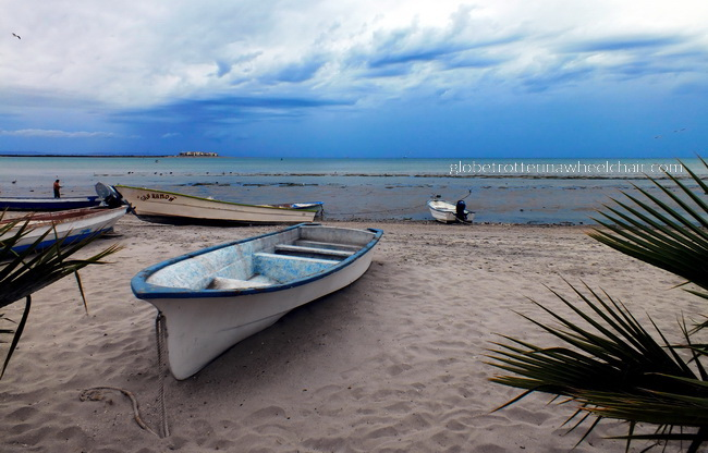 view of La Paz bay in Mexico, with boat in front © curiousKester.com | Kirsten K. Kester