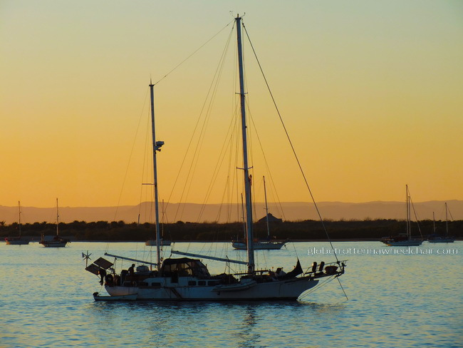 sunset and view of La Paz bay in Mexico, with boat in front © curiousKester.com | Kirsten K. Kester