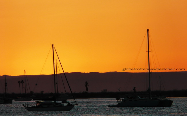 sunset and view of La Paz bay in Mexico, with boats © curiousKester.com | Kirsten K. Kester