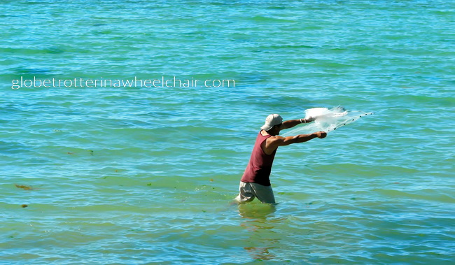 fisherman throwing a net in La Paz bay in Mexico © curiousKester.com | Kirsten K. Kester