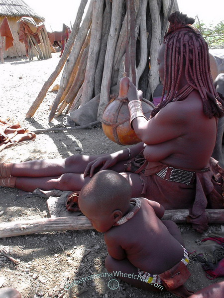 """The Himba people in wonderful Namibia - Butter making in calabash, """"ondjupa"""". Namibia"""