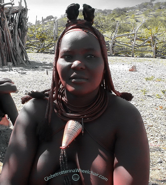 """The Himba people in wonderful Namibia - Married women wears the large """"ohumba"""" shell and a small crown made (""""erembe"""" leather headdress) of goat skin on their heads. Namibia"""
