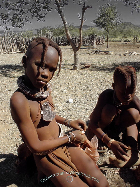 """The Himba people in wonderful Namibia - Girls wear their hair in two braids over their forhead (""""ozondatu""""). Namibia"""